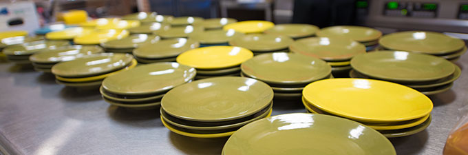 plates lined up in kitchen