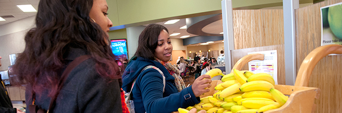 Students grabbing fresh fruit on their way to class